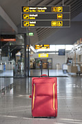 Airport Concourse Posters - Luggage Sitting Alone in an Airport Terminal Poster by Jaak Nilson
