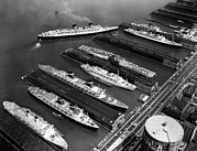 Ocean Liner Framed Prints - Luxury Liners Flanking An Aircraft Framed Print by Everett