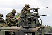 40mm Art - Machine Gunners Fire Machine Guns by Stocktrek Images