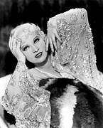Embellished Framed Prints - Mae West, In Beaded Dress, On Fur Rug Framed Print by Everett