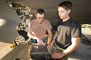 Mechanic Framed Prints - Maintenance Crew Works On An F-22 Framed Print by HIGH-G Productions