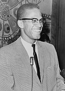 Malcolm X Prints - Malcolm X 1925-1965 Speaking In 1964 Print by Everett