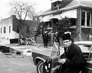 Malcolm X Prints - Malcolm X, Returns Home After His House Print by Everett