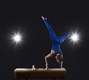 Young Man Posters - Male Gymnast Doing Handstand On Pommel Horse Poster by Mike Harrington