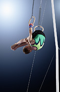 World Series Prints - Male Gymnast Performing Somersault On Rings Print by Robert Decelis Ltd