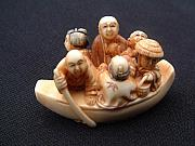 Music Sculptures - Mammoth tusk ivory netsuke featuring 4 men and 2 women riding in a tiny boat by Contemporary netsuke artist