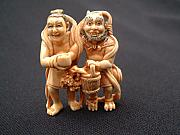Music Sculptures - Mammoth tusk ivory netsuke featuring Ema-O and an oni by Contemporary netsuke artist