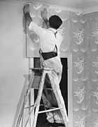 Home Improvement Framed Prints - Man Applying Wallpaper Framed Print by George Marks