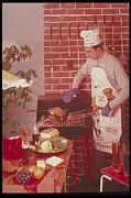 35-39 Years Posters - Man Barbecuing A Meal, 1980s Poster by Archive Holdings Inc.