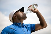 Bottled Photo Prints - Man Drinking Bottled Water Print by