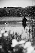 Relaxed Photo Framed Prints - Man Flyfishing In A Lake In Ireland Framed Print by Joe Fox