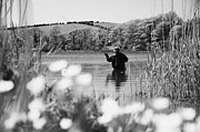Relaxed Photo Framed Prints - Man Flyfishing On Lake In Ireland Framed Print by Joe Fox