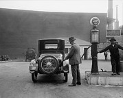 License Plates Prints - Man Fueling His Car At A Self-service Print by Everett