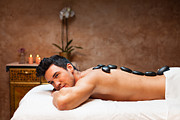 Man Having Lastone Therapy In Spa Center Print by Slobodan Vasic