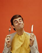35-39 Years Posters - Man Holds Up A Knife And Fork, 1960s Poster by Archive Holdings Inc.