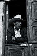 Old Man With Hat Framed Prints - Man in a Door Framed Print by Andres Barria Davison