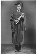 Young Men Posters - Man  In Graduation Gown Posing In Studio, (b&w), Portrait Poster by George Marks