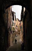 Siena Italy Framed Prints - Man in street-Siena Framed Print by Jim Wright