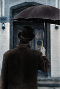 Front Porch Framed Prints - Man in Top Hat with Umbrella In Front of Door Framed Print by Jill Battaglia