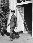 Manual Framed Prints - Man In Uniform Walking Out Door Framed Print by George Marks