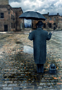 Brick Street Framed Prints - Man in Vintage Clothing with Umbrella on Rainy Brick Street Framed Print by Jill Battaglia