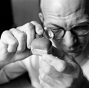 Man Looking At Miniture Loaf Of Bread Through Magnifying Glass Print by Hulton Archive