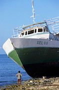 Ashore Framed Prints - Man looking up at a beached passenger ship on Cozumel Island Framed Print by Sami Sarkis
