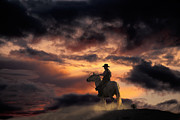 Sundown Prints - Man on Horseback Print by Ron Sanford and Photo Researchers