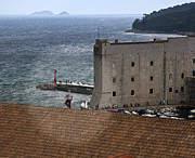 Red Roof Photos - Man on the Roof in Dubrovnik by Madeline Ellis