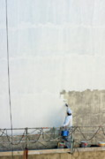 Men At Work Posters - Man painting the facade of a building Poster by Sami Sarkis