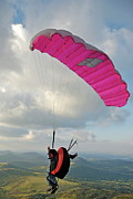 Young Man Framed Prints - Man paragliding off hill Framed Print by Sami Sarkis