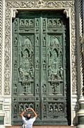 Destinations Digital Art Prints - Man picturing main entrance door of Florence Duomo Print by Sami Sarkis