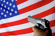 Threats Prints - Man pointing gun on American flag Print by Sami Sarkis