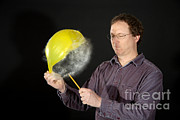 Popping Photos - Man Popping A Balloon by Ted Kinsman
