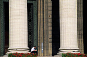 France La Madeleine Metal Prints - Man reading a book beside the columns of La Madeleine church in Paris Metal Print by Sami Sarkis
