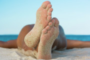 Lifestyles Posters - Man relaxing on the beach Poster by MotHaiBaPhoto Prints