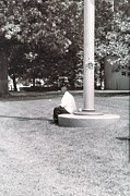 Man Resting At Pole Print by Floyd Smith