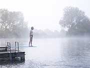 Haze Photo Framed Prints - Man Standing On Diving Board In Outdoor Lake Framed Print by Peter Beavis