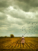 Trenchcoat Posters - Man Walking In a Farm Field Poster by Jill Battaglia