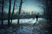 Snowy Trees Prints - Man walking in snow at winter twilight Print by Sandra Cunningham
