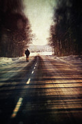 Atmosphere Prints - Man walking on a rural winter road Print by Sandra Cunningham