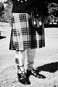 Kilt Posters - Man Wearing Traditional Scottish Dress Including Clan Fraser Tartan Kilt Sporran Hose And Brogues Sc Poster by Joe Fox