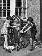 10:11 Prints - Mangling The Washing Print by Kurt Hutton