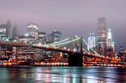 Christmas Lights Photos - Manhattan And Brooklyn Bridge Under Fog. by Shobeir Ansari