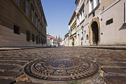 Sewage Framed Prints - Manhole Cover on a Street in Hradcany Framed Print by Jeremy Woodhouse
