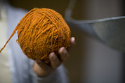 Mans Hand Holds Ball Of Orange Wool Print by David Evans