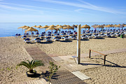 Lounger Prints - Marbella Holiday Beach Print by Artur Bogacki