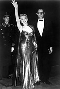 Opera Gloves Photo Prints - Marilyn Monroe Waves To The Crowd Print by Everett