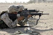 Assault Rifles Photo Framed Prints - Marine Fires Their M16a2 Service Rifles Framed Print by Stocktrek Images