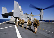 Uniforms Metal Prints - Marines Board An Mv-22 Osprey Aboard Metal Print by Stocktrek Images